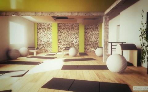 Rénovation d'un ancien garage en salle de Pilates avec mur en pierres